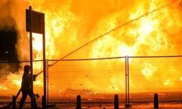 Firefighter at Sandyrow Bonfire (Belfast Telegraph)